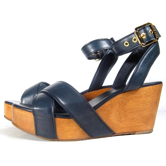 2eefa8de9c9 Tory Burch Almita Ankle Strap Wood Sandal Wedges. M 5afc405c6bf5a6a4c88e5a3d